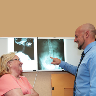 Dr. Scott reviewing xrays with patient