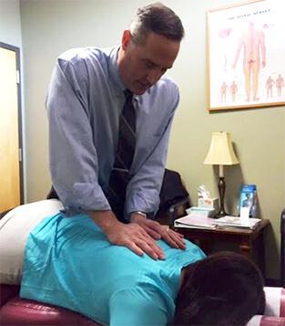 Dr. Caliri performing adjustment