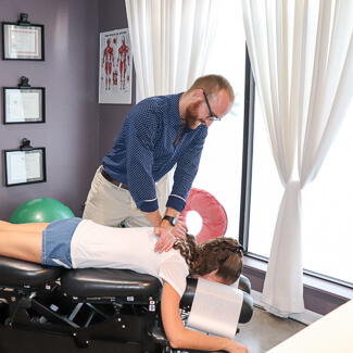 Dr. Luke adjusting thoracic area