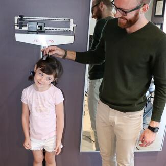 Dr. Luke weighing child