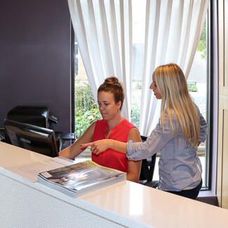Staff consulting at front desk