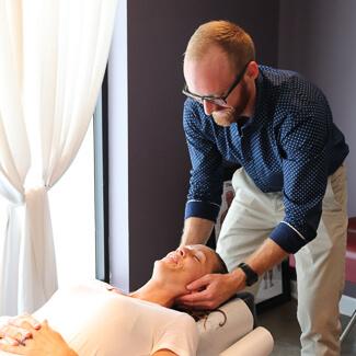 Dr. Luke performing cervical adjustment