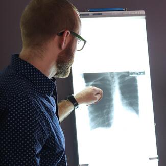 Dr. Luke looking at xrays