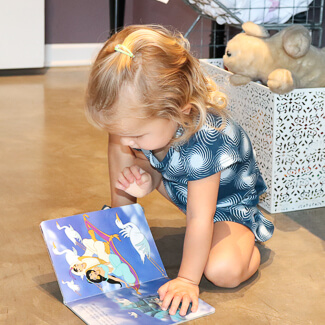 Little girl looking at book