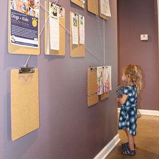 Little girl looking at wall