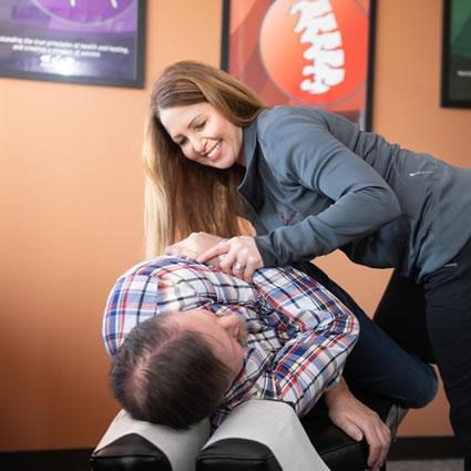 Dr. Pepping adjusting man