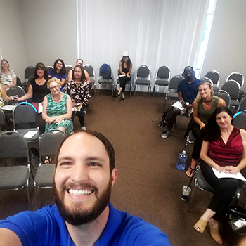 Dr. Bowman with people at Chiropractic Seminar