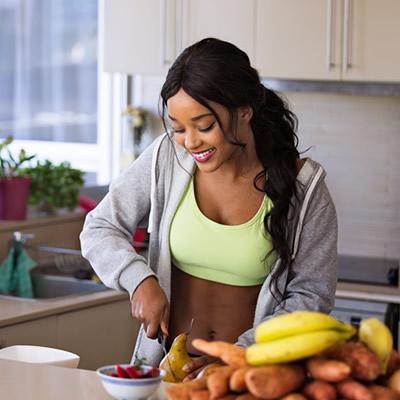 Fit woman preparing healthy meal