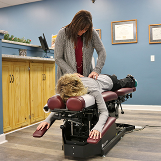 Chiropractic adjustment by Dr. Power