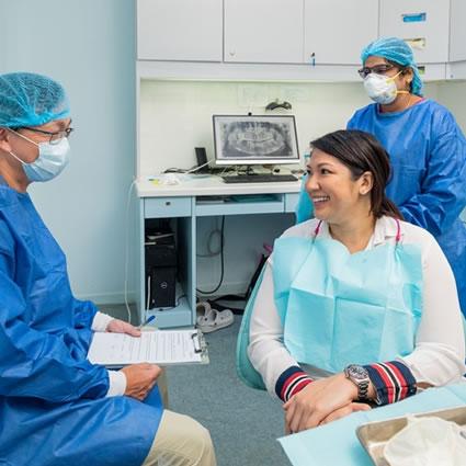 Dentist speaking with client