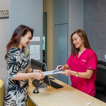 Staff handing patient paperwork