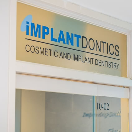 Implantdontics Cosmetic and Implant Dentistry signage