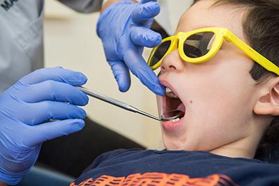 Dentist checking child's teeth