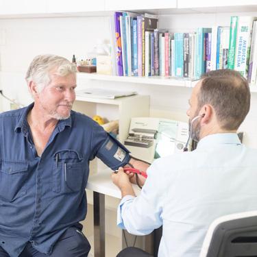 Stuart Morick taking a patient's blood pressure