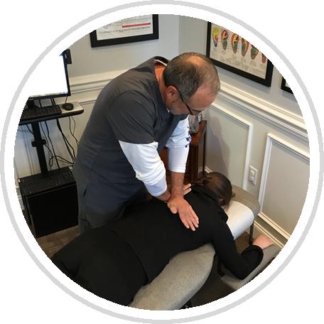 Dr. Daniel adjusting patient