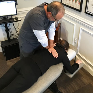 Chiropractic adjustment by Dr. Daniel