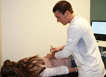 Dr. Evan adjusting woman