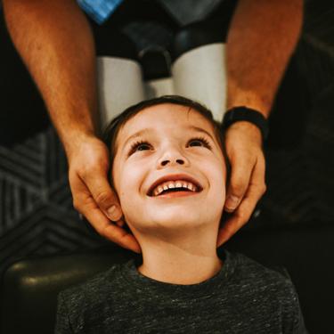happy boy getting adjusted