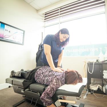 Dr. Pannu adjusting patient