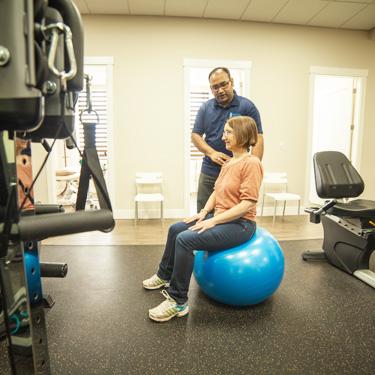 Patient on balance ball