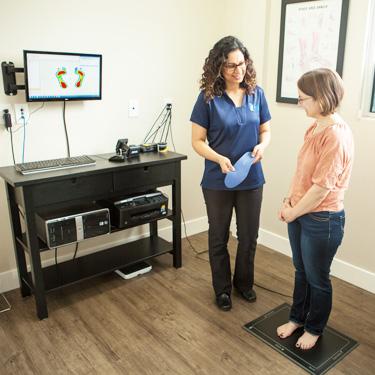 Dr. Pannu scanning patient's foot