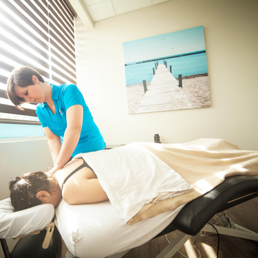 massage therapist and patient