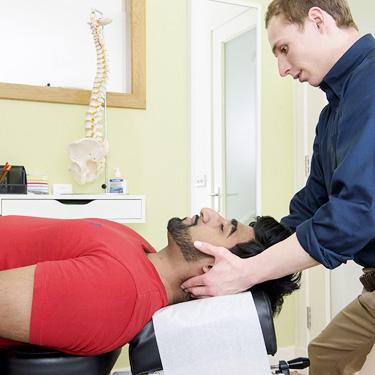 Dr. Michael Adjusting