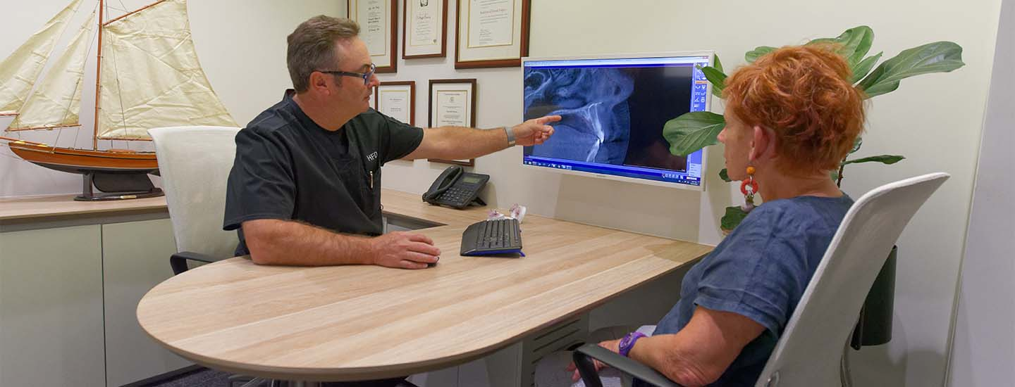 Dentist reviewing xray with patient