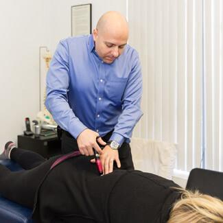 Dr. Joseph adjusting patient