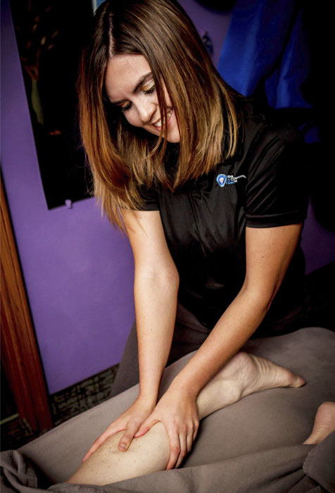 Therapist massaging leg