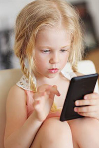 Small child using an iPhone