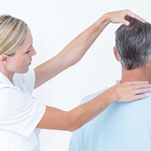 chiropractor adjusting a patient's neck