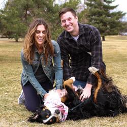 Dr. Lindsay and husband playing with dog
