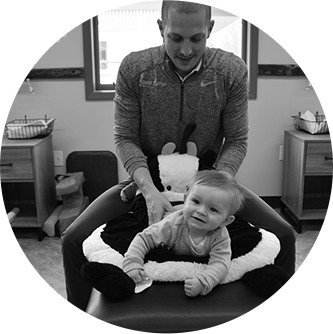 Chiropractor adjusting a baby