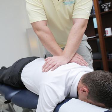 Dr Paul Klich adjusting a patient's spine