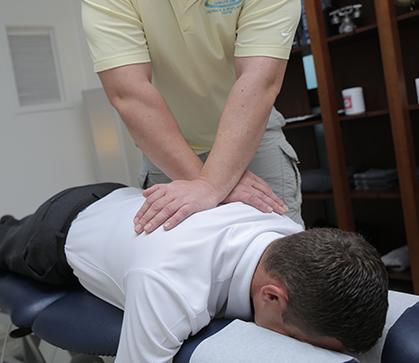 Dr Paul Klich adjusting a patient