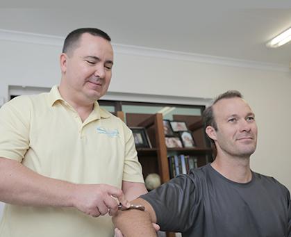 Dr Paul Klich treating a patient