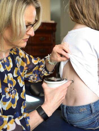 Dr. Cindy scanning little girl