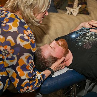 Dr. Cindy adjusting man