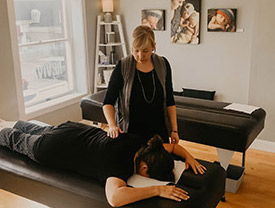 Man getting adjusted on table