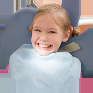 Smiling, little girl in dentist chair