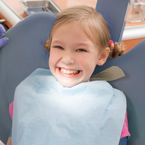 Smiling little girl in dental chair