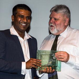 Dr Dumi receiving award
