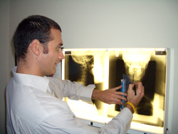 A chiropractor analyzing an x-ray