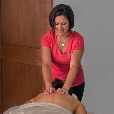 Our massage therapist working on a client