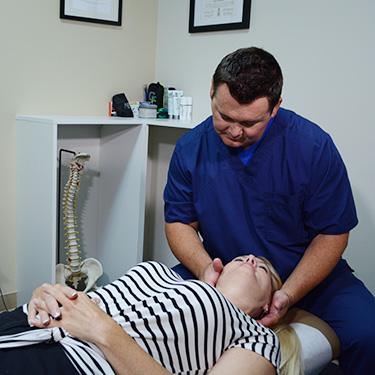 Dr. Hogan adjusting patient