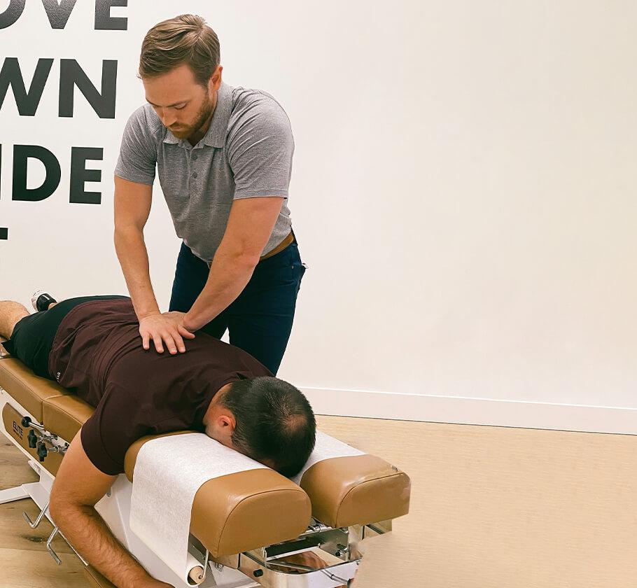 Dr Tyler adjusting mans back