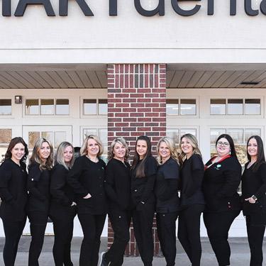 hart dental team standing front of office