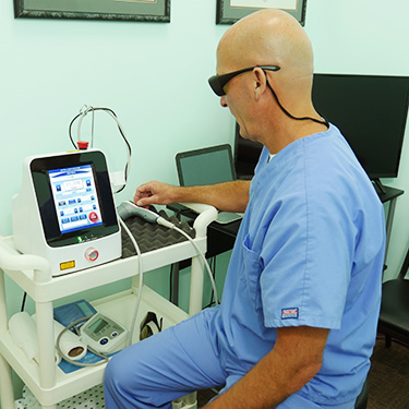 Dr. Gary with laser equipment