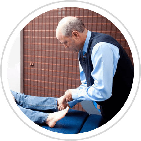 Dr. Thoma adjusting patients foot